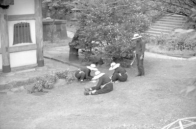 Japanese gardeners patiently grooming the lawn. 1965