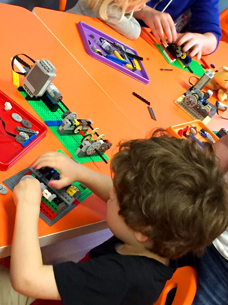 Gates creates an egg coloring machine with Legos at STEMful