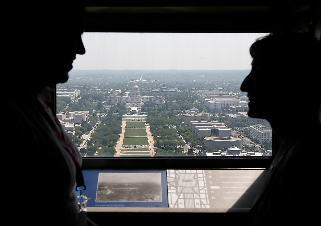 . Kristin Beck, a former United States Navy SEAL, left, talks with Interior Secretary Sally Jewell inside the Washington Monument in Washington, Monday, May 12, 2014, looking toward the Capitol, after a ceremony which celebrated its re-opening.  (AP Photo)