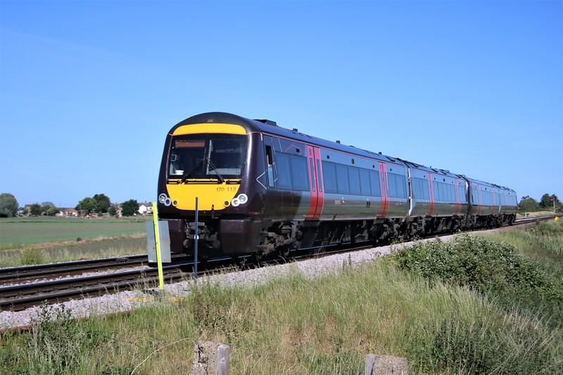 170112_170111 passing Wisbech Road crossing, Manea at 0942/1L30 Birmingham to Cambridge