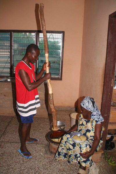 Pounding fufu in Sunyani, Ghana.  Fufu is made from boiled plantain and casava; it is pounded in the traditional way to a doughy consistency, then is added to a spicy soup to be served.