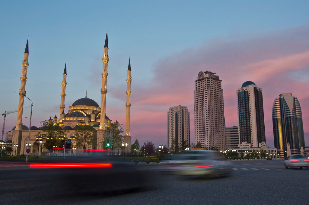. Cars drive along Akhmad Kadyrov Avenue, with the Heart of Chechnya mosque and skyscrapers in the background in the Chechen capital Grozny April 27, 2013. The naming of two Chechens, Dzhokhar and Tamerlan Tsarnaev, as suspects in the Boston Marathon bombings has put Chechnya - the former site of a bloody separatist insurgency - back on the world\'s front pages. Chechnya appears almost miraculously reborn. The streets have been rebuilt. Walls riddled with bullet holes are long gone. New high rise buildings soar into the sky. Spotless playgrounds are packed with children. A giant marble mosque glimmers in the night.Yet, scratch the surface and the miracle is less impressive than it seems. Behind closed doors, people speak of a warped and oppressive place, run by a Kremlin-imposed leader through fear.   Picture taken April 27, 2013.   REUTERS/Maxim Shemetov