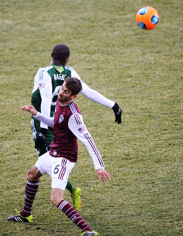 . COMMERCE CITY MARCH 22: Jose Mari of Colorado Rapids (6), front, and Darlington Nagbe of Portland Timbers (6) are in action in the 2nd half of the game at Dick\'s Sporting Goods Park. Commerce City, Colorado. March 22. 2014. Colorado won 2-0. (Photo by Hyoung Chang/The Denver Post)