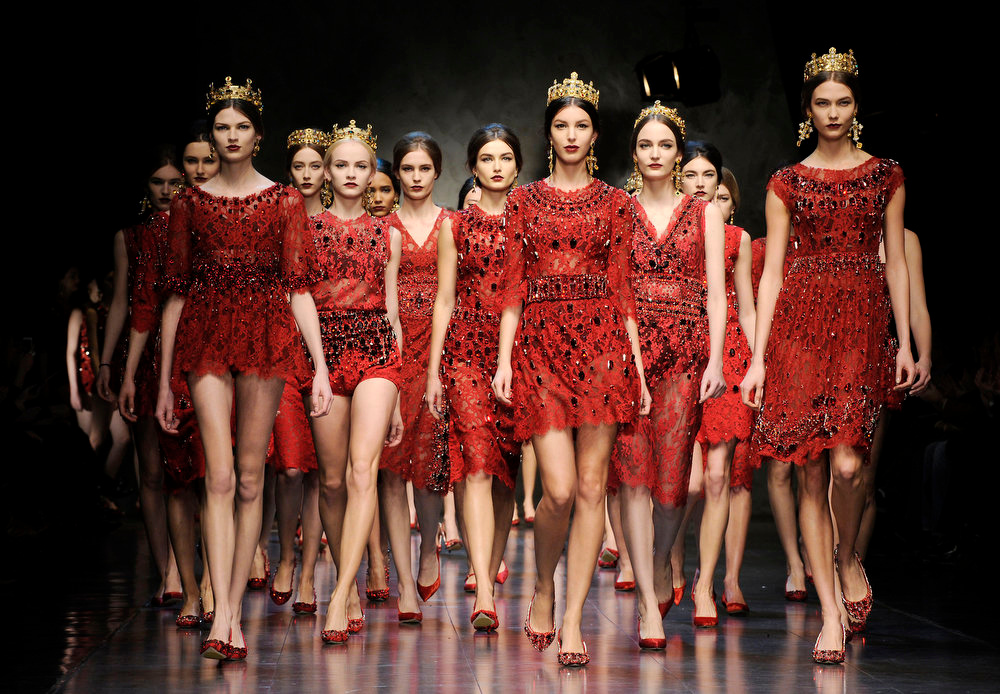 Description of . Models wear creations for Dolce & Gabbana women's Fall-Winter 2013-14 collection, part of the Milan Fashion Week, unveiled in Milan, Italy, Sunday, Feb. 24, 2013. (AP Photo/Giuseppe Aresu)