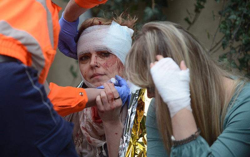 . A paramedic bandages a woman injured by a powerful gas blast on April  29, 2013 in Prague\'s historic center. The blast injured up to 20 people, four seriously, rescuers said, adding that it was possible some people were buried in the rubble. MICHAL CIZEK/AFP/Getty Images