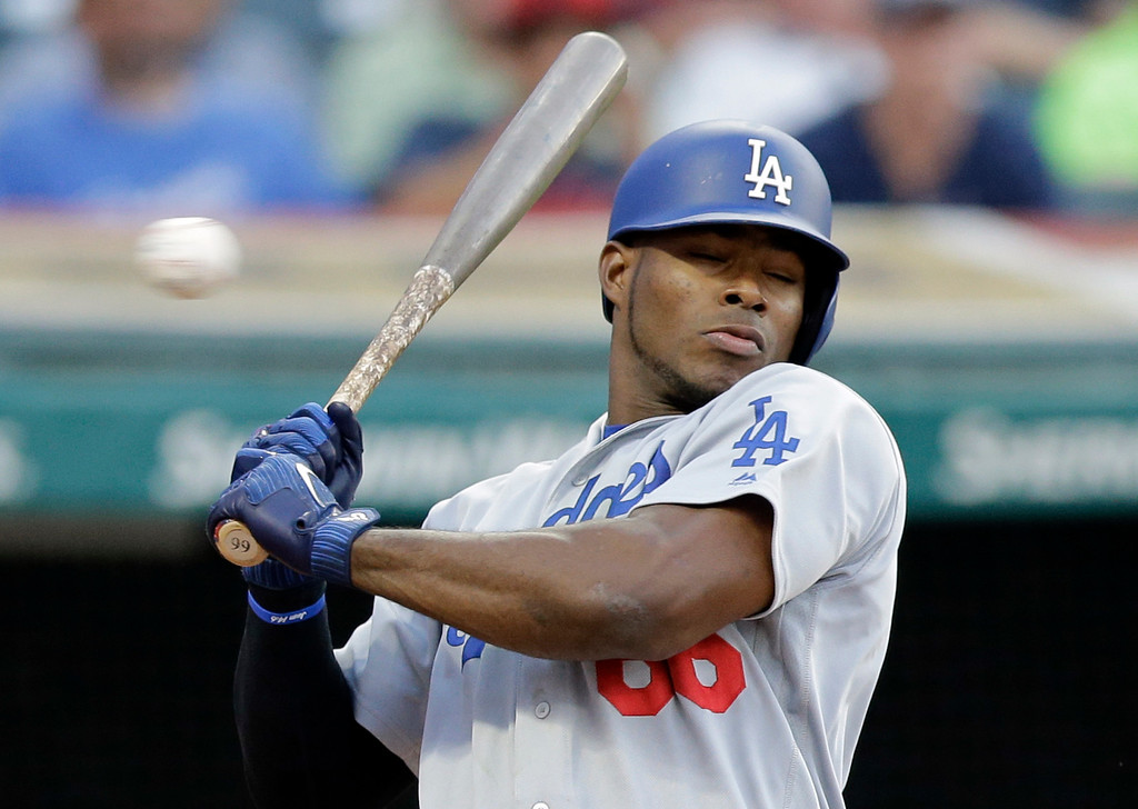. Los Angeles Dodgers\' Yasiel Puig avoids an inside pitch from Cleveland Indians starting pitcher Trevor Bauer during the fourth inning of a baseball game, Tuesday, June 13, 2017, in Cleveland. (AP Photo/Tony Dejak)