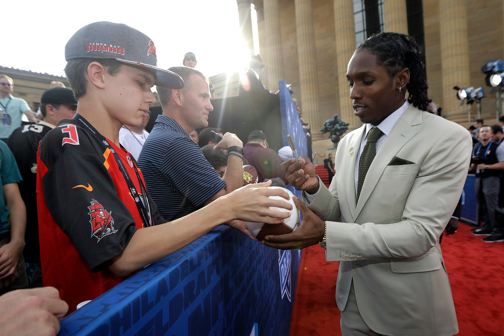 . Southern California\'s Adoree\' Jackson signs autographs for fans before the first round of the 2017 NFL football draft, Thursday, April 27, 2017, in Philadelphia. (AP Photo/Julio Cortez)