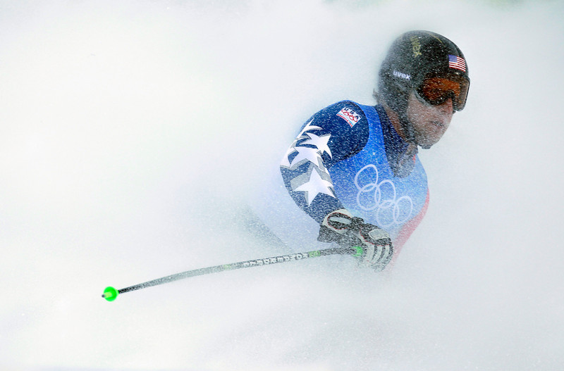. Andrew Weibrecht of the United States stops in the finish area as he completes the downhill portion of the Men\'s super-combined at the Vancouver 2010 Olympics in Whistler, British Columbia, Sunday, Feb. 21, 2010. (AP Photo/Sergey Ponomarev)