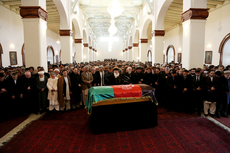 . Afghan President Hamid Karzai, center second row, prays amongst others during the funeral procession of Afghanistan\'s influential Vice President Mohammad Qasim Fahim in Kabul, Afghanistan, Tuesday, March 11, 2014. Fahim, a leading commander in the alliance that fought the Taliban who was later accused with other warlords of targeting civilian areas during the country\'s civil war, died on Sunday, March 9, 2014. He was 57. (AP Photo/Rahmat Gul)
