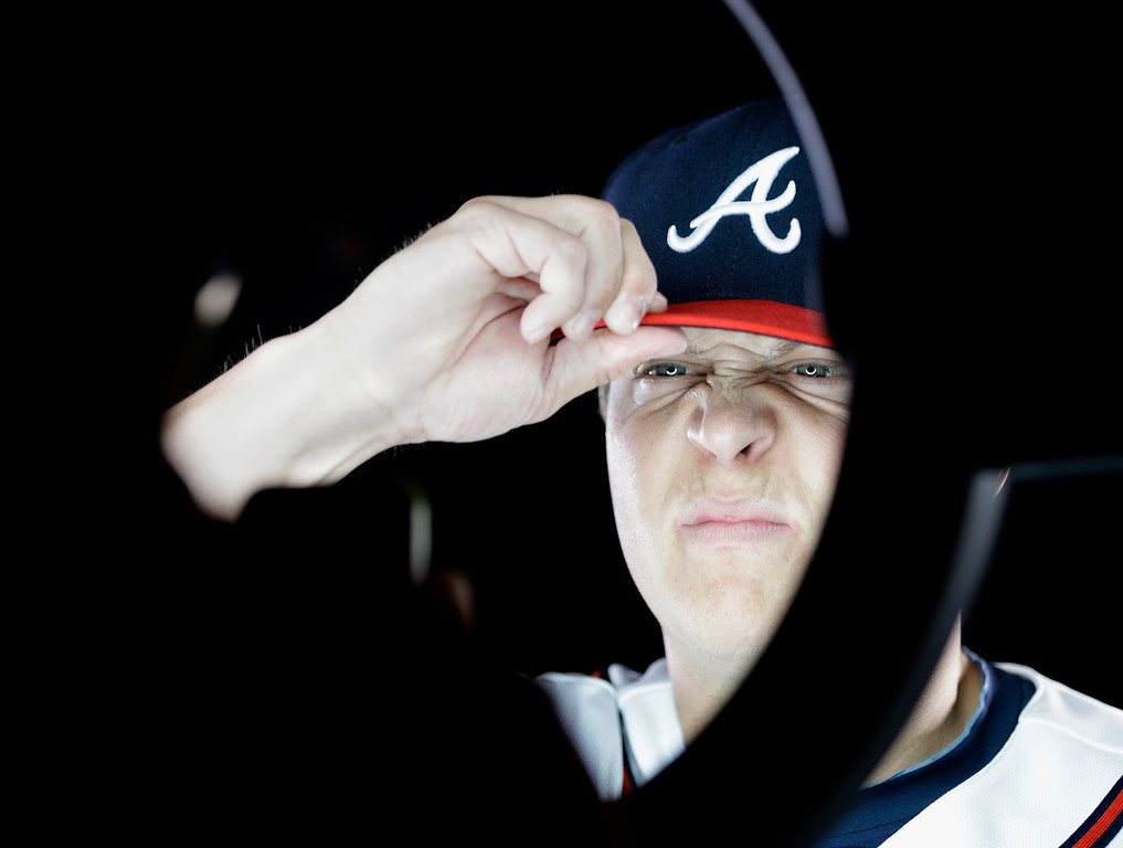 . Atlanta Braves pitcher Kris Medlen squints as he poses for a photographer during a spring training baseball picture day Wednesday, Feb. 20, 2013, in Kissimmee, Fla. (AP Photo/David J. Phillip)