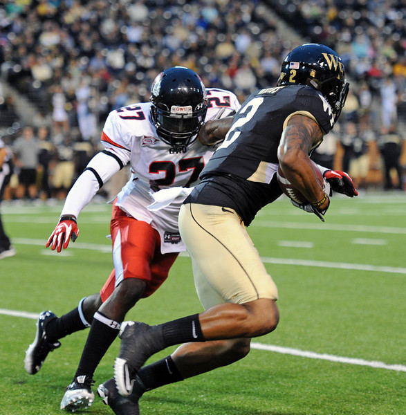 Chris Givens catch and tackled.jpg
