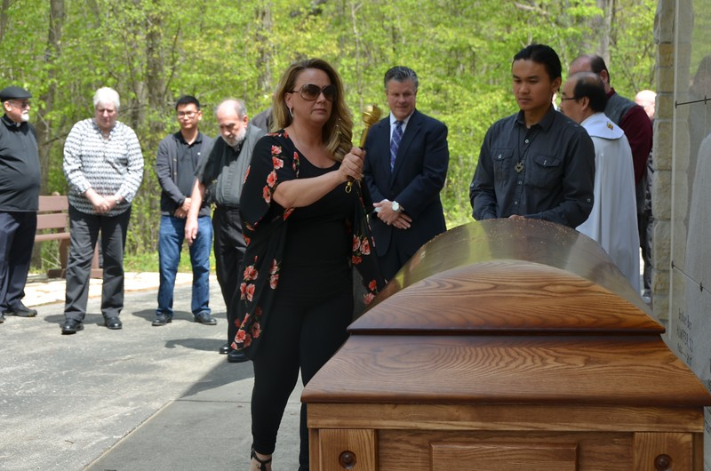 June sprinkles the casket