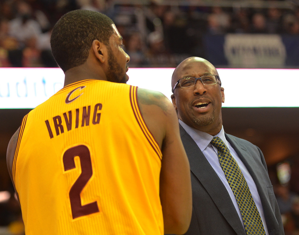 . Michael Allen Blair/Digital First Media Cavs\' guard Kyrie Irving talks things over with head coach Mike Brown after a foul call during the first quarter of Wednesday\'s game at Quicken Loans Arena. Big questions remain with Irving heading into the final year of his contract next season.