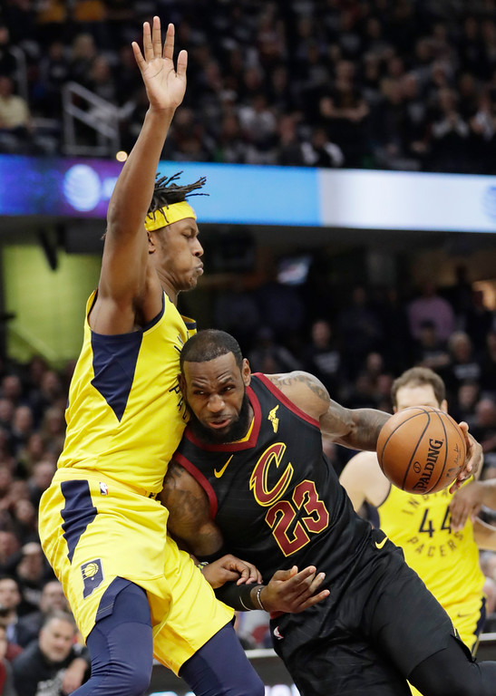 . Cleveland Cavaliers\' LeBron James (23) dries to the basket against Indiana Pacers\' Myles Turner (33) in the first half of Game 7 of an NBA basketball first-round playoff series, Sunday, April 29, 2018, in Cleveland. (AP Photo/Tony Dejak)