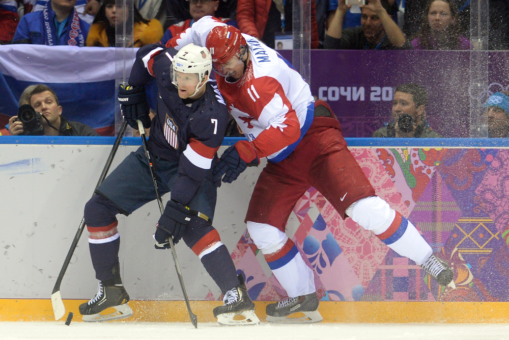 . Yevgeni Malkin (11) of the Russia skates into the back of Paul Martin (7) of the U.S.A. during  the third period of the U.S.A.\'s shootout-win at Bolshoy arena. Sochi 2014 Winter Olympics on Saturday, February 15, 2014. (Photo by AAron Ontiveroz/The Denver Post)