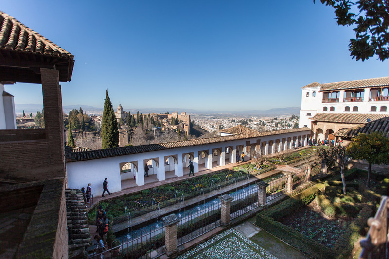 A view of the gardens and the city from inside the Generalife at the Alhambra in Granada, Spain.