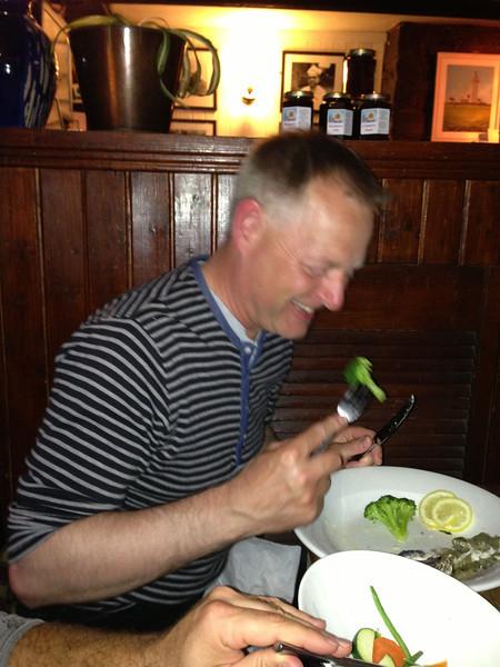 Lars eating his broccoli.