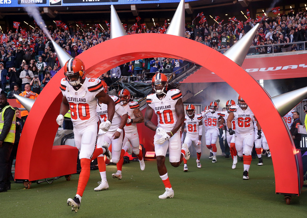 . Cleveland Browns players run onto the field before an NFL football game against Minnesota Vikings at Twickenham Stadium in London, Sunday Oct. 29, 2017. (AP Photo/Matt Dunham)