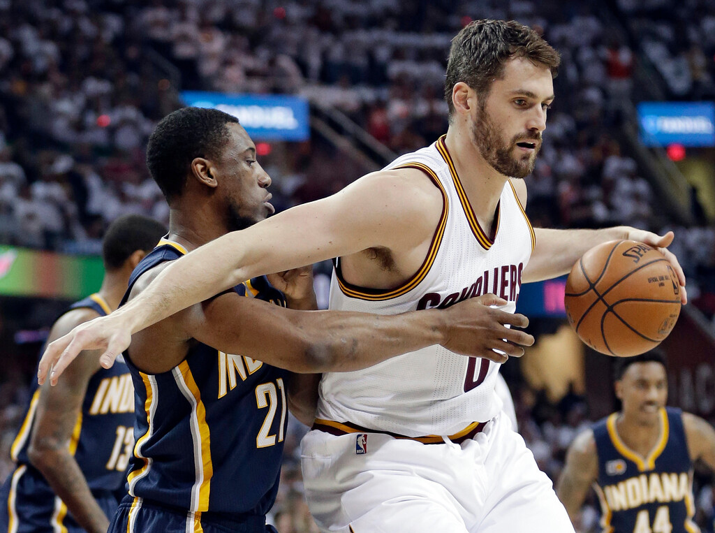 . Indiana Pacers\' Thaddeus Young, left, puts pressure on Cleveland Cavaliers\' Kevin Love in the first half in Game 1 of a first-round NBA basketball playoff series, Saturday, April 15, 2017, in Cleveland. (AP Photo/Tony Dejak)