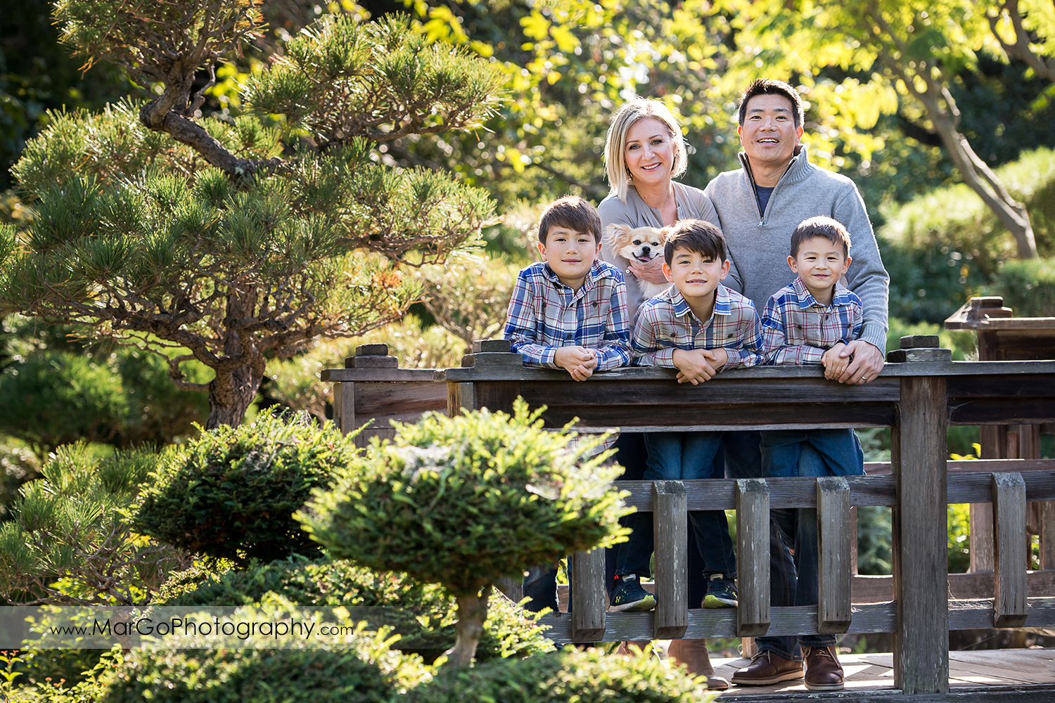 wide angle portrait of family of 5 on wood bridge at Hayward Japanese Garden