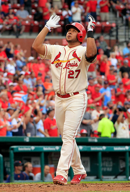 . St. Louis Cardinals\' Jhonny Peralta celebrates as he reaches home after hitting a solo home run during the sixth inning of a baseball game against the Detroit Tigers Saturday, May 16, 2015, in St. Louis. (AP Photo/Jeff Roberson)