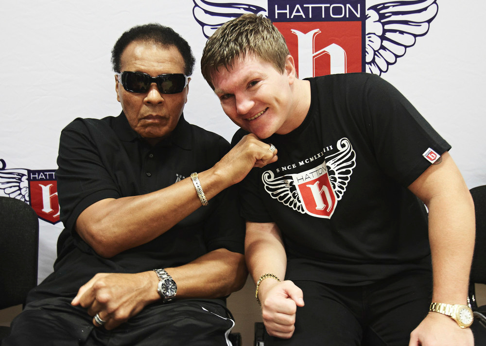 Description of . Boxing great Muhammad Ali delivers a knockout blow to Ricky Hatton in a guest appearance at Hatton's  gym in Manchester, England, Wednesday, Aug. 26, 2009.  The appearance is part of a tour of the UK and Ireland to help promote Ali's charitable work. (AP Photo/MJ Kim/PictureGroup)