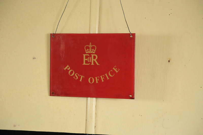 """South of the Antarctic Circle., this UK Post office sign is at  Detaille Island, British scientific base """"W"""" at 66˚52'S, 66˚48'W"""