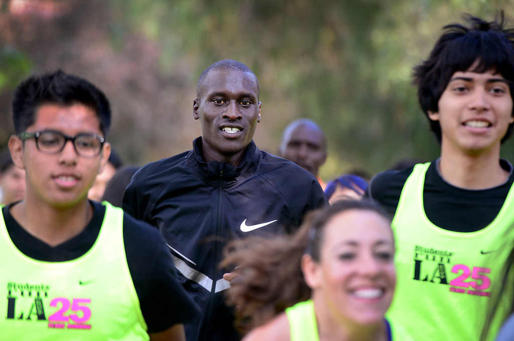 . Elite marathon runner Lani Rutto, of Kenya, joins students, of the Students Run LA program, for a short run as elite athletes train at Griffith Park in Los Angeles Friday, March 7, 2014 for the LA Marathon. The students will also be running Sunday\'s marathon. (Photo by Sarah Reingewirtz/Pasadena Star-News)