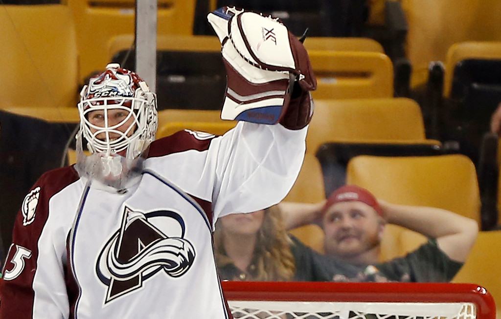 . Colorado Avalanche goalie Jean-Sebastien Giguere celebrates after the Avalanche defeated the Boston Bruins 2-0 in an NHL hockey game in Boston on Thursday,  Oct. 10, 2013. (AP Photo/Winslow Townson)