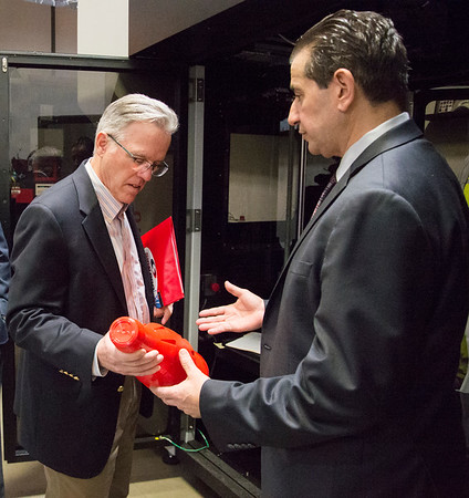 02/10/20 Wesley Bunnell | StaffrrCT State Chief Manufacturing Officer Colin Cooper visited Sign Pro, Inc. in Southington on Monday February 10, 2020. Cooper, L, is handed a prototype of a 3d printed object which helps in the design process.