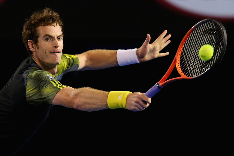 . Andy Murray of Great Britain plays a backhand in his men\'s final match against Novak Djokovic of Serbia during day fourteen of the 2013 Australian Open at Melbourne Park on January 27, 2013 in Melbourne, Australia.  (Photo by Julian Finney/Getty Images)