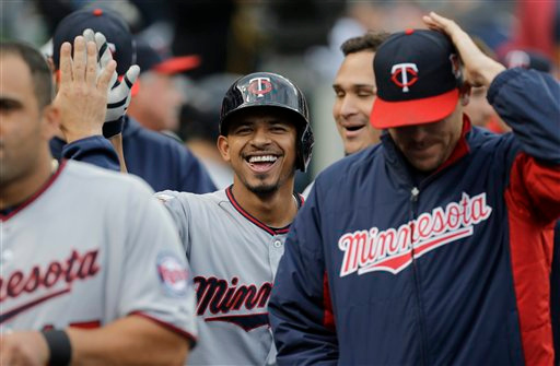 . Minnesota Twins\' Eduardo Escobar celebrates his solo home run against the Detroit Tigers in the third inning of a baseball game in Detroit, Friday, June 13, 2014.  (AP Photo/Paul Sancya)