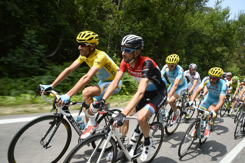 . Italy\'s Vincenzo Nibali (L) wearing the overall leader\'s yellow jersey rides in the pack beside Luxembourg\'s Frank Schleck (2ndL) during the 161 km eighth stage of the 101st edition of the Tour de France cycling race on July 12, 2014 between Tomblaine and Gerardmer La Mauselaine, eastern France.  (LIONEL BONAVENTURE/AFP/Getty Images)