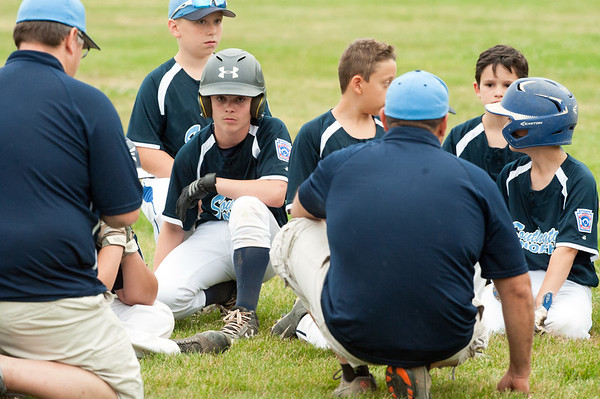 06/27/18 Wesley Bunnell | Staff Forestville Little League defeated Southington North 2-0 on Wednesday afternoon in Southington. Coaches speak to their players after the game down the right field line.