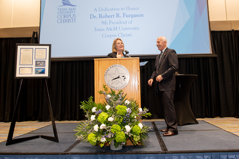 President and CEO of TAMU-CC Dr. Kelly Quintanilla presents President Emeritus Dr. Robert Furgason with a recognition award during the Furgason Engineering Building naming ceremony on December 7, 2018 at Texas A&M University-Corpus Christi.