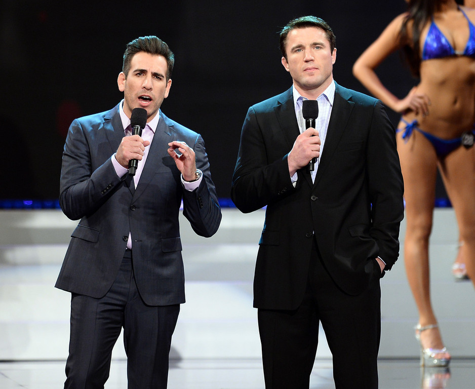 . Former mixed martial artist Kenny Florian (L) and mixed martial artist Chael Sonnen host the 17th annual Hooters International Swimsuit Pageant at The Joint inside the Hard Rock Hotel & Casino on June 27, 2013 in Las Vegas, Nevada.  (Photo by Ethan Miller/Getty Images)