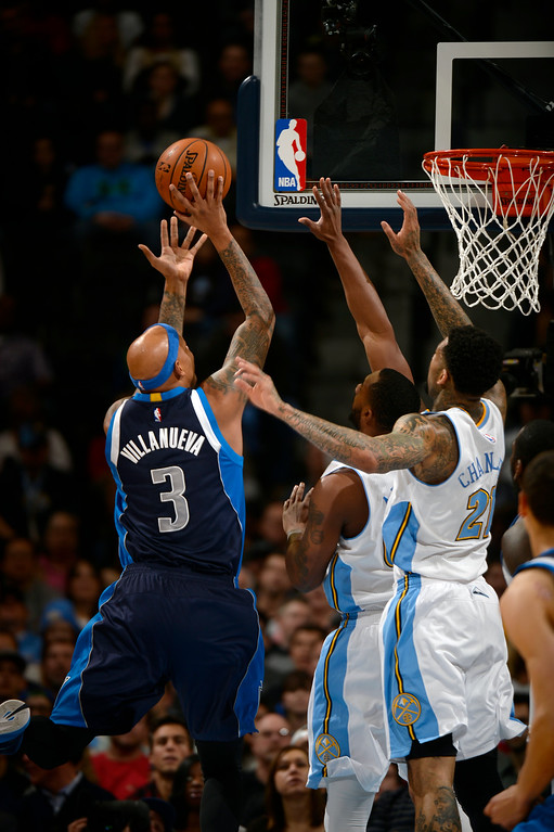 . DENVER, CO - JANUARY 14: Dallas Mavericks forward Charlie Villanueva (3) goes up for a shot past Denver Nuggets forward Wilson Chandler (21) during the first quarter January 14, 2015 at Pepsi Center. (Photo By John Leyba/The Denver Post)