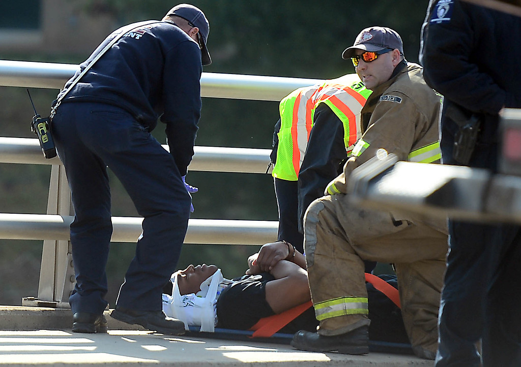 . Firefighters tend to Carolina Panthers NFL football quarterback Cam Newton following a two-vehicle crash not far from the team\'s stadium in Charlotte, N.C., Tuesday, Dec. 9, 2014. (AP Photo/The Charlotte Observer, Todd Sumlin)