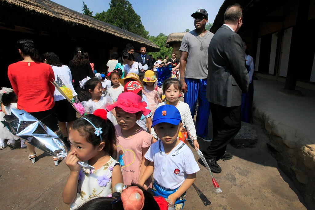. Former NBA basketball star Dennis Rodman, second right, towers over North Korean children during his visit to Mangyongdae, the birth place of late North Korean leader Kim Il Sung on Wednesday, June 14, 2017, in Pyongyang, North Korea. (AP Photo/Kim Kwang Hyon)