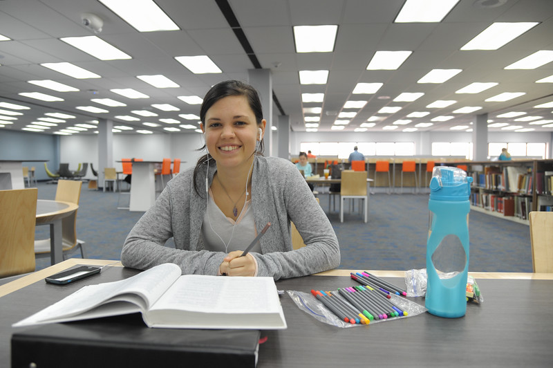 DeAnna Henson working on her psychology assignment at the Mary and Jeff library.