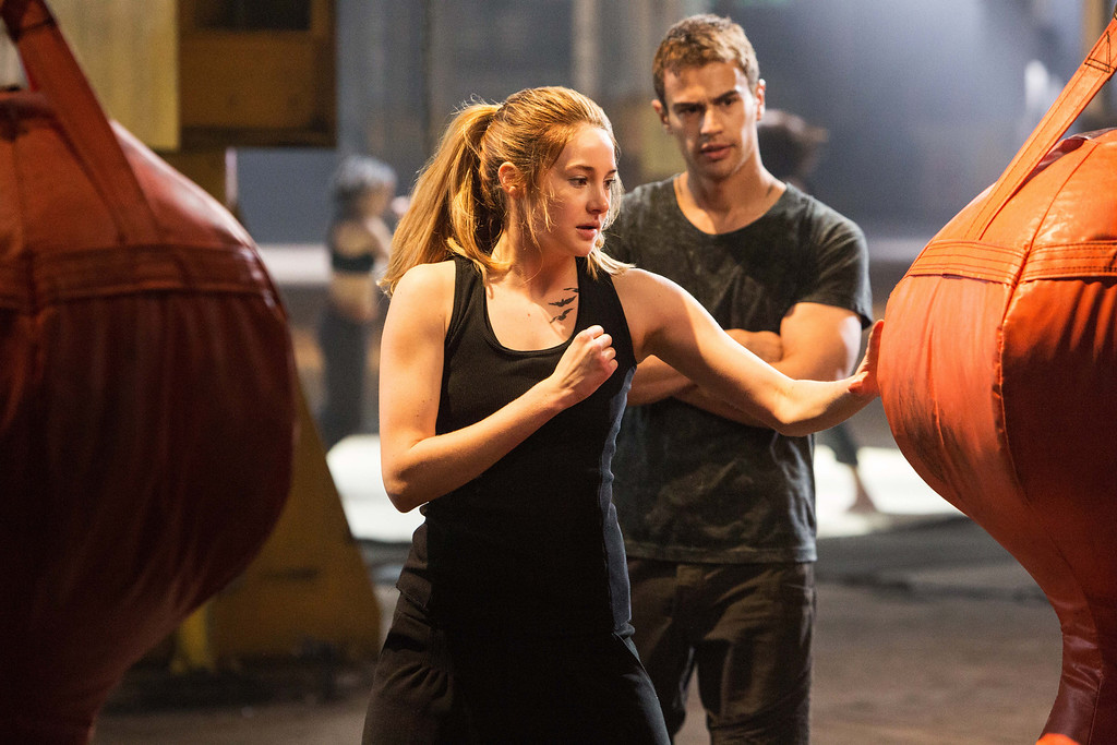 """. This photo released by Summit Entertainment, LLC shows Shailene Woodley as Beatrice \""""Tris\"""" Prior, left, and Theo James as Four, in the film, \""""Divergent.\"""" (AP Photo/Summit Entertainment, Jaap Buitendijk)"""