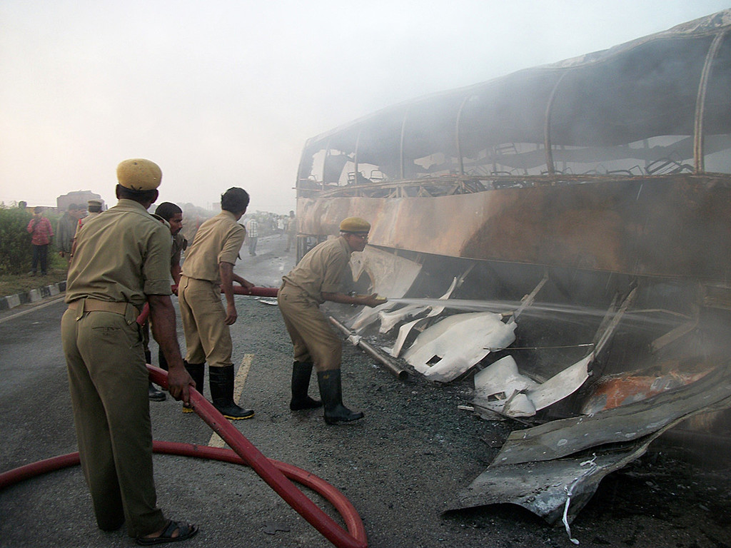 . Indian personnel douse a burning bus which was traveling from Bangalore to Hyderabad, on the highway in Mahbubnagar district of the southern Andhra Pradesh state, about 140 kms from Hyderabad on October 30, 2013.    AFP PHOTOSTR/AFP/Getty Images