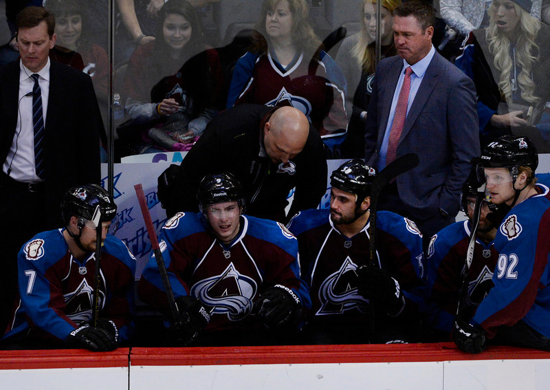 . Colorado Avalanche center, Matt Duchene, second from left, sits on the bench in pain after colliding with teammate, Jamie McGinn, (not pictured) early in the first period against the San Jose Sharks Saturday afternoon at the Pepsi Center March 29, 2014.  Duchene headed into the locker room. (Photo By Andy Cross / The Denver Post)