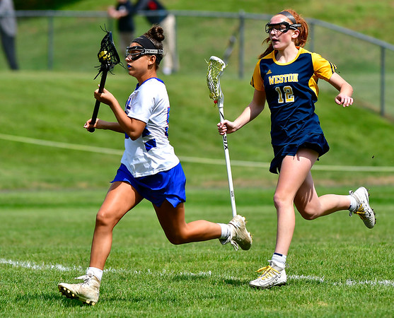5/29/2019 Mike Orazzi | Staff St. Paul's Catherine Ciampi (2) and Weston's Taylor Werner (12) during Wednesday's Class S First Round lacrosse match in Bristol.