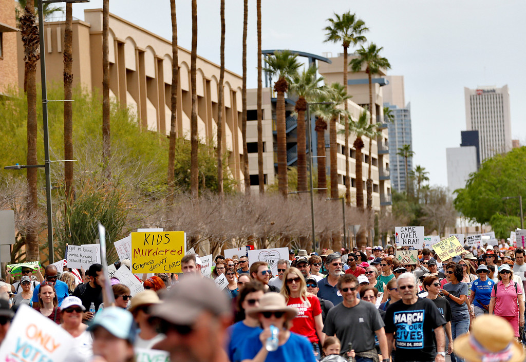 . People participate in the March For Our Lives rally at the Capitol Saturday, March 24, 2018, in Phoenix. The nationwide student-led protest is demanding stricter gun laws in the wake of the Valentine Day\'s shooting that killed 17 in Parkland, Florida. (AP Photo/Matt York)