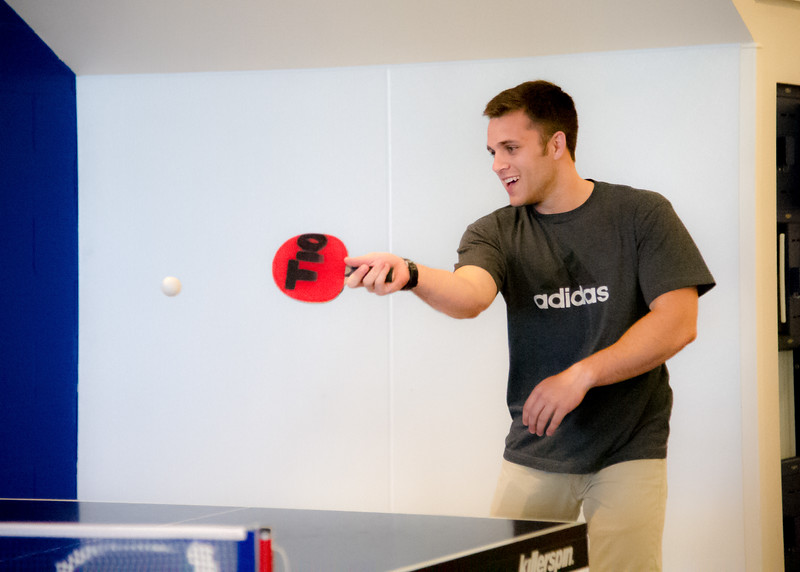 Student Austin Capunay plays a game ping pong in the Dugan Wellness Center.