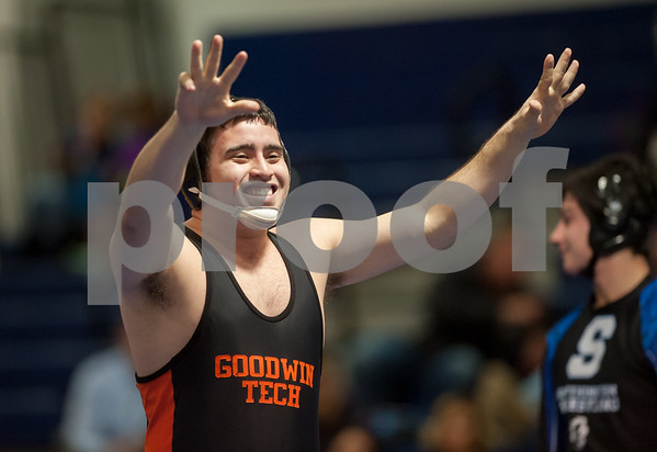 02/08/18 Wesley Bunnell   Staff Eduardo Morales who travels with the New Britain High Wrestling team as the lone member of the E.C. Goodwin Tech Wrestling program. Here Morales raises his hands after his victory at Southington High School on Thursday night.