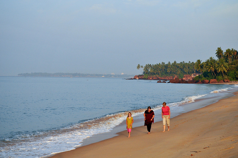 The women walk on the beach on the Indian Ocean.