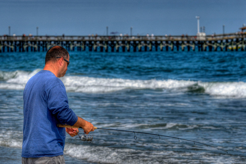 A man fishes near the Springmaid Pier in Myrtle Beach State Park in Myrtle Beach, SC on Saturday, April 14, 2012. Copyright 2012 Jason Barnette