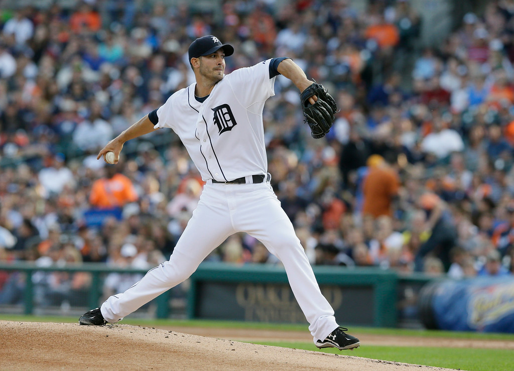 . Detroit Tigers starting pitcher Rick Porcello throws during the first inning of a baseball game against the Seattle Mariners, Friday, Aug. 15, 2014 in Detroit. (AP Photo/Carlos Osorio)